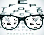Glasses sitting on an eye chart